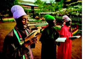 """Featured image is captioned: """"Jamaica (2011), Facing east, Rastafarians chant psalms from the King James Bible. Kingston, Jamaica."""""""