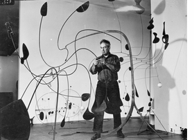 Alexander Calder installing the exhibition Alexander Calder: Sculptures and Constructions, 1943. The Museum of Modern Art Archives, New York. Artwork by Alexander Calder © 2021 Calder Foundation, New York / Artists Rights Society (ARS), New York.