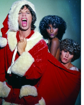 """Photographer Ara Gallant's dazzling photographs, like this wild holiday portrait of Mick Jagger, supermodel Iman, and model/photographer Paul Van Ravenstein from 1977, were truly a reflection of his personality. In her introduction to <a href=""""http://www.artbook.com/9788862081207.html"""">Ara Gallant</a>, Anjelica Houston explains, """"When Ara danced, we girls followed. He was in his element and so were we. He could pivot two six-foot models in Manolo's with the greatest of ease. He could transform a dance floor, make a room crackle, turn the lights down low."""" <p>From all of us at DAP and ARTBOOK, we wish you Merry Christmas and a Happy New Year!"""