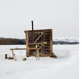 "Richard Johnson, ""Ice Hut #556, Cochrane, Ghost Lake, Alberta, Canada,"" (2011) is reproduced from <I>Cabin Fever</I>."