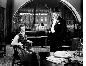 Featured image of Thereza with Postant (Nigel Bruce) in his office is reproduced from <i>Charlie Chaplin: Footlights with The World of Limelight</i>.