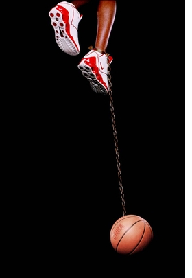 """Basketball and Chain"" (2003), by Hank Willis Thomas, is reproduced from 'Common Practice Basketball.'"