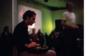 Reproduced from 'Common Tones,' featured photograph is of Alan Licht (left) and projectionist Terry Daniels (right) performing with Text of Light in 2004 for Arika, Kill Your Timid Notion 04, at Dundee Contemporary Arts, Scotland. Photo Bryony McIntyre.