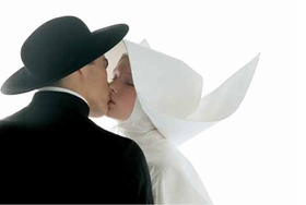 """Featured image, """"Kissing-nun"""" by Oliviero Toscani (1992) is reproduced from <I>Controversies</I>."""