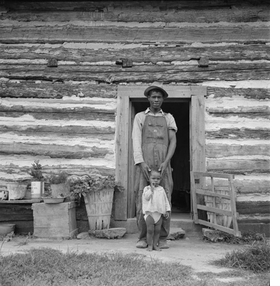 """""""Young Sharecropper and His First Child, Hillside Farm, Person County, North Carolina"""" (1939) is reproduced from <I>Dorothea Lange: Aperture Masters of Photography</I>."""