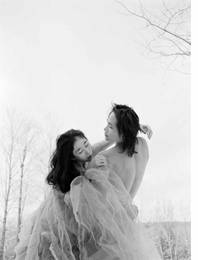 """Featured image, by Philip Trager, captures Eiko & Koma at Jacob's Pillow in the winter of 1993. Reproduced from the <a href=""""walkerartcenter.html"""">Walker Art Center's</a> complete, illustrated catalogue of Eiko & Koma's dance works, <a href=""""9780935640977.html"""">Time Is Not Even, Space Is Not Empty</a>, this image is accompanied by the following text on collaborating by Trager: """"It was freezing. I photographed Eiko & Koma, half-clad, on ice and snow. There was no heat or water. Aborting the project was out of the question. Alert and attentive to one another, we shared a single-minded resolve. Our work together was totally open, often informing each other without words. This was shared creative impetus at its best.<br> But this should have come as no surprise. Even before I started photographing them, I knew that we were totally attuned to one another, that everything would work out beautifully. The day before I arrived, Eiko & Koma chose locations for our session. I then chose some myself. From the myriad possibilities at Jacob's Pillow, we had selected exactly the same sites."""""""
