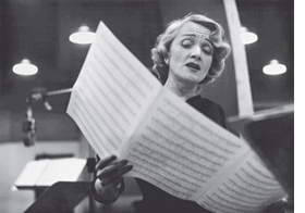 """Featured image is captioned: """"Marlene Dietrich at the recording studios of Columbia Records, singing songs she made famous during the Second World War. New York, 1952."""""""