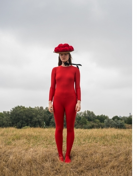 "Kirsten Becken's ""Lady in Red"" (2019) is reproduced from 'Female Photographers Org: The Body Issue.'"