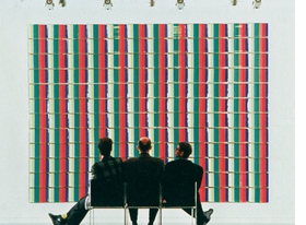 """Featured image, <i>General Idea in front of 'Test Pattern: T.V. Dinner Places from the Miss General Idea Pavillion'</i>, 1988, is produced from <a href=""""9783037641620.html"""">General Idea: A Retrospective 1969-1994</a>."""