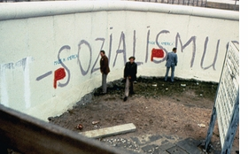Featured image is a view of Matta-Clark's 1976 performance <i>The Wall</i> in which he painted text such as 'Made In America' and collaged advertisements over graffiti onto the Berlin Wall.