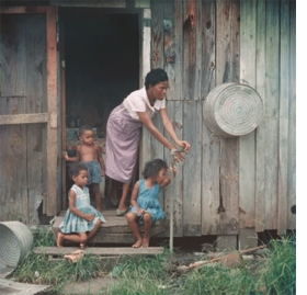 """""""Mother and Children, Mobile, Alabama"""" (1956) is reproduced from <I>Gordon Parks: Segregation Story</I>."""