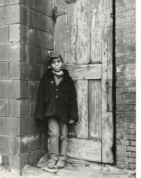 """""""Boy in Doorway"""" (1941/42) is reproduced from 'Gordon Parks: The New Tide.'"""