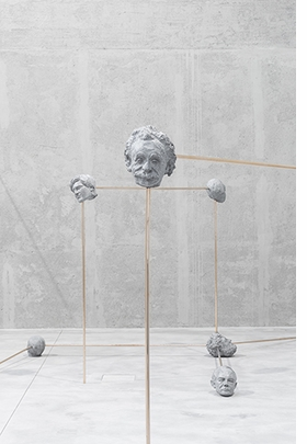 """Detail of """"International Institute of Intellectual Co-operation, Configuration 6, Humanity's Survival: Jared Diamond, Jean-François Lyotard, Francis Bacon, Friedrich Nietzsche, Paul Crutzen, Nick Bostrum, HP Lovecraft, Michel Foucault"""" (2015), installed at Fondazione Prada, is reproduced from <I>Goshka Macuga: Before the Beginning and after the End</I>."""