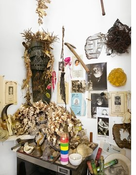 "Featured image, of ""The Black Christ"" (1967), surrounded by a constellation of wishbones, fish skeletons, photographs and memorial programs in Jack Whitten's Woodside, Queens, studio, is reproduced from 'Jack Whitten: Odyssey.'"