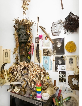 """Featured image, of """"The Black Christ"""" (1967), surrounded by a constellation of wishbones, fish skeletons, photographs and memorial programs in Jack Whitten's Woodside, Queens, studio, is reproduced from 'Jack Whitten: Odyssey.'"""