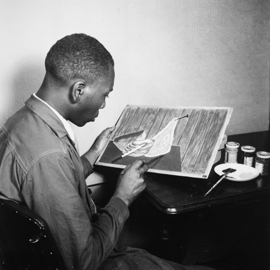 Featured image, Jacob Lawrence with <I>Migration Series</I> panel 44, ca. 1941, National Archives, Harmon Foundation Collection, is reproduced from <I>Jacob Lawrence: The Migration Series</I>.