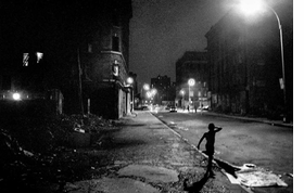 """Featured image, """"Boy On East 5th Street, 4th of July"""" (1984), is reproduced from the 2014 Steidl edition of <I>Ken Schles: Invisible City</i>. Below is the book trailer."""