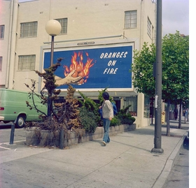 """Featured image, """"Oranges on Fire, Billboard, Silk Screen Prints produced by Foster & Kleiser Outdoor Advertising, 10' x 22', San Francisco, CA,"""" 1975, is reproduced from <I>Larry Sultan & Mike Mandel</I>."""