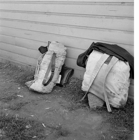 "Featured image, captioned ""Bindles on shady side of Pastime Café. Siskiyou County, Tulelake, California"" (August 1939), is reproduced from 'Last West: Roadsongs for Dorothea Lange.'"