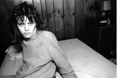 Mary Ellen Mark: Tiny, Streetwise Revisited, Tiny Sitting on the Bed