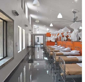 Featured image, showing UVGI lights in one of the wards of the Butaro Hospital, is reproduced from <I>MASS Design Group: Empowering Architecture</I>.
