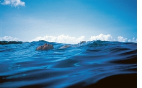 """""""Christine Floating in the Waves, St. Barth's"""" (1999) is reproduced from 'Nan Goldin.'"""