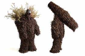 """Featured image, two 2007 <I>Soundsuits</I> fabricated with sticks, dried plants and fabric, plus appliqué and embroidery, is reproduced from <a href=""""9780615245935.html"""">Nick Cave: Meet Me at the Center of the Earth</a>."""