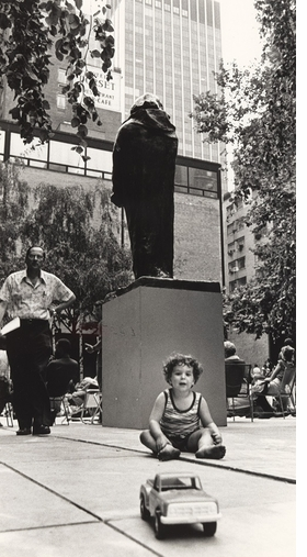 "Featured photograph, of a child playing beneath Rodin's ""Monument to Balzac"" (1898; cast 1954), is reproduced from 'Oasis in the City.'"