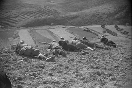 Featured image, of Republican soldiers lying on the ground aiming rifles, Aragón front, Spain, August 1936, is reproduced from 'Robert Capa: Death in the Making.'