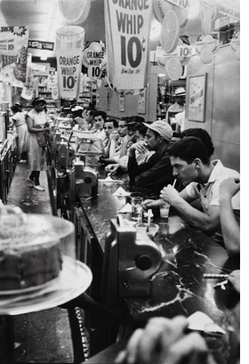 """""""Drugstore, Detroit"""" (1955) is reproduced from <I>Robert Frank: The Americans</I>."""