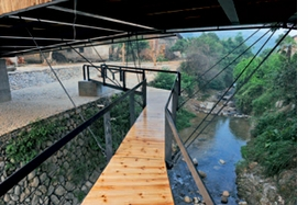 The Bridge School, featured above, connects two ancient fortresses in Xiashi Village, China. The image is reproduced from <I>Testify! The Consequences of Architecture</I>.