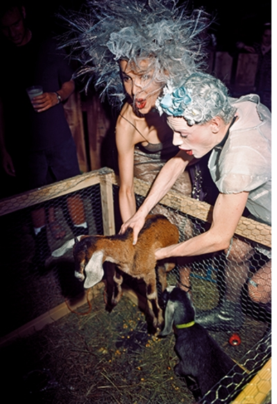 The Isaac Mizrahi Pictures: New York City 1989–1993. Photographs by Nick Waplington, club kids with goat