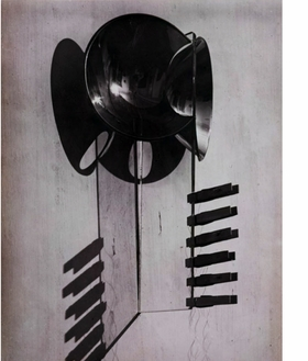 """""""As Arturo Schwarz indicates, 'up to the late 1940s most of Man Ray's objects were assembled chiefly to provide unusual subjects for unconventional photographs. Once they had served this purpose they were discarded, dismantled, forgotten or lost.'"""" <p>  The image featured here is one of those photographs Schwarz describes. Man Ray's <i>Woman</i>, 1918, and the excerpt above, are from <a href=""""http://www.artbook.com/9780870707575.html"""">The Original Copy: Photography of Sculpture, 1839 to Today.</a>"""