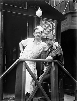 """""""Short Order Cook and Worker in Lunchroom Doorway on Second Avenue, New York City,"""" 1932, is reproduced from <i>Walker Evans: Aperture Masters of Photography</i>."""
