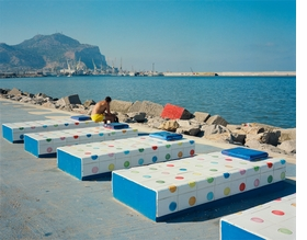 """Featured Wim Wenders photograph, <i>Sun Bather, Palermo</i>, is accompanied by text from the artist: <i>""""'Nothing exists without its opposite.' (Who the heck said that?) But what could the opposite of this be? And where would it exist? I couldn't help thinking that this 'beach scene' in Palermo was already part of a parallel world.""""</i>"""
