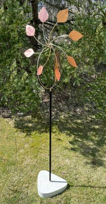 COPPER PETALS ON STAND WITH CEMENT BASE