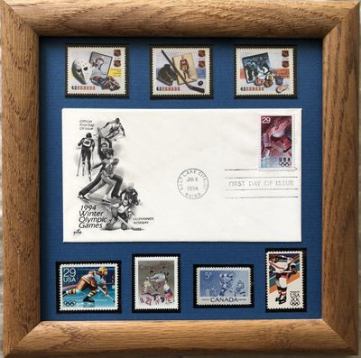 1994 Winter Olympics First Day Cover plus 7 different Canada and USA Hockey stamps matted and framed