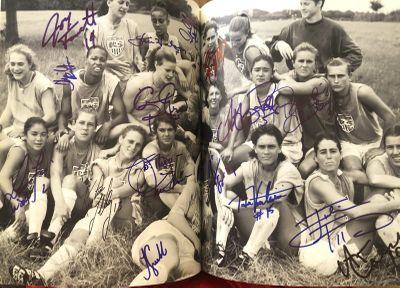 1996 US Olympic Team book autographed by 37 including Gold Medal Soccer and Softball Teams Dominique Moceanu John Godina Mike Powell (JSA)