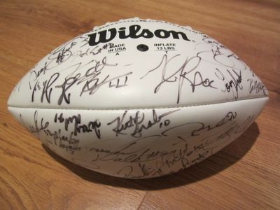 1999 NFL Players autographed football (Tiki Barber Tim Brown Marshall Faulk Daryl Johnston Andre Reed Thurman Thomas Herschel Walker Rod Woodson)