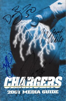 2001 San Diego Chargers media guide autographed by Rodney Harrison David Binn Tim Dwight Marcellus Wiley