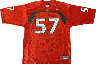 2012 Miami Hurricanes team autographed orange Nike jersey (Allen Hurns Denzel Perryman)