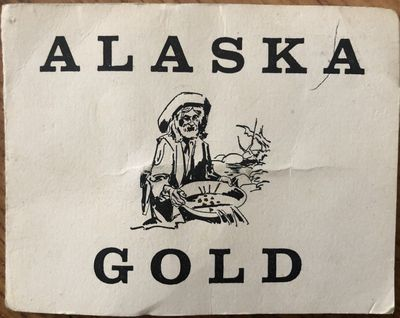 Alaska Placer Gold flakes in vial and souvenir folder