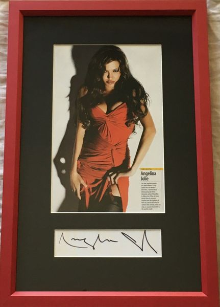 Angelina Jolie autograph matted and framed with sexy magazine photo (JSA Auction LOA)
