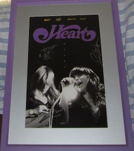 Ann Wilson and Nancy Wilson autographed HEART 11x17 poster matted & framed
