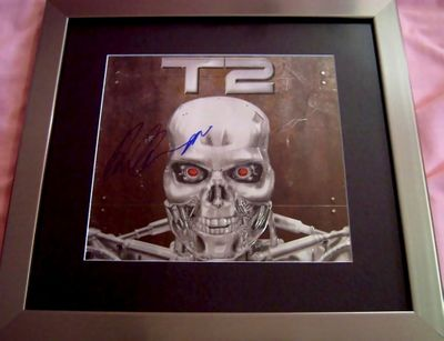 Arnold Schwarzenegger autographed Terminator 2 movie embossed logo matted and framed