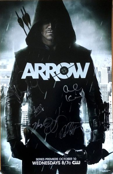 Stephen Amell and Katie Cassidy autographed Arrow 2012 Comic-Con poster