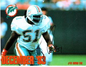 Bryan Cox autographed Miami Dolphins 1993-1994 calendar page photo