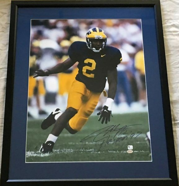 Charles Woodson autographed Michigan Wolverines 16x20 inch poster size photo inscribed Heisman '97 matted and framed (GTSM)