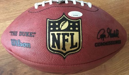Charles Woodson autographed Wilson NFL game model leather football (JSA)