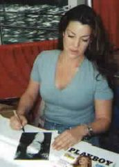 Claudia Christian autographed sexy 8x10 photo